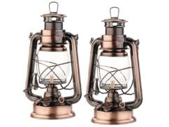"""Deux lampes à pétrole """"Anika"""" aspect bronze Lunartec."""