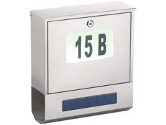 Boîte aux lettres avec numéro de maison lumineux.