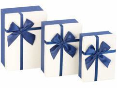 3 paquets-cadeaux avec boucle bleue
