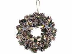 Couronne de l'Avent lumineuse de 30 centimètres de diamètre avec pommes de pin et reflets verts.